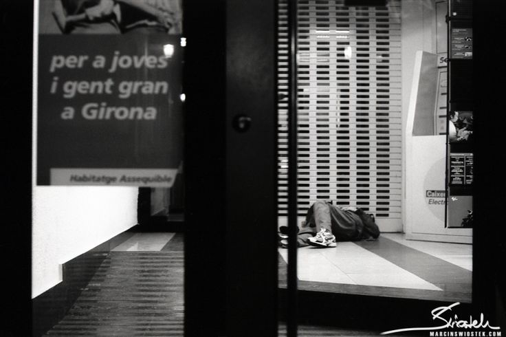 Homeless man in an ATM vestibule.