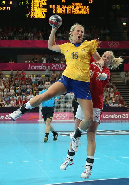 Johanna Ahlm of Sweden shoots and scores a goal in the Women's Handball preliminaries Group B - Match 4 between Denmark and Sweden on Day 1 of the London 2012 Olympic Games at the Copper Box on July 28, 2012 in London, England.