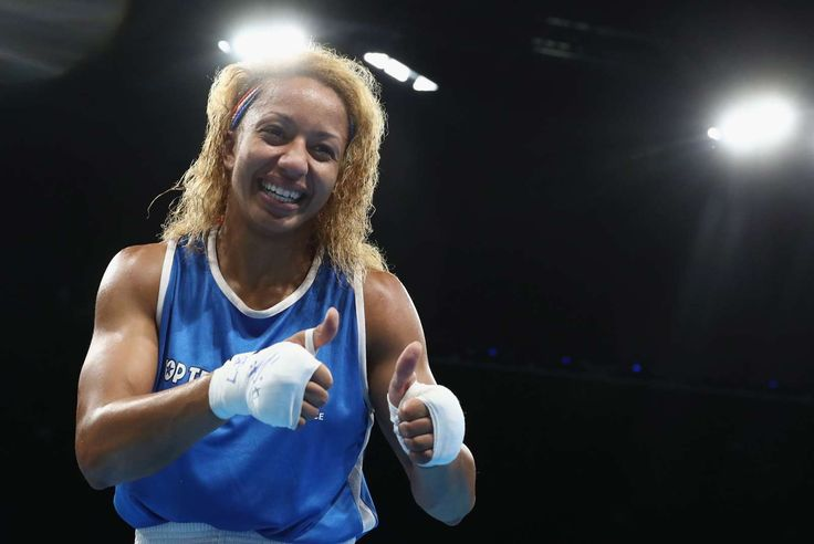 French boxer through to the semis:    Estelle Mossely of France celebrates after…
