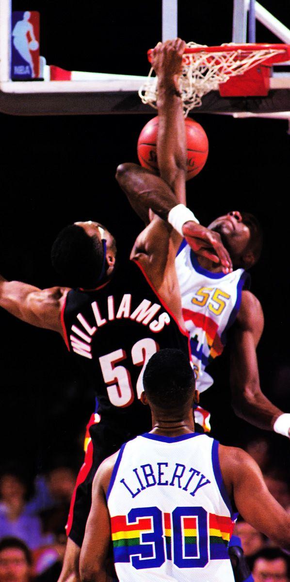 Buck Williams dunks on Dikembe Mutombo