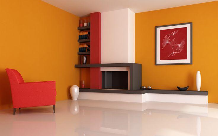 Tus muebles rojos quedarán increíbles con paredes naranjas.