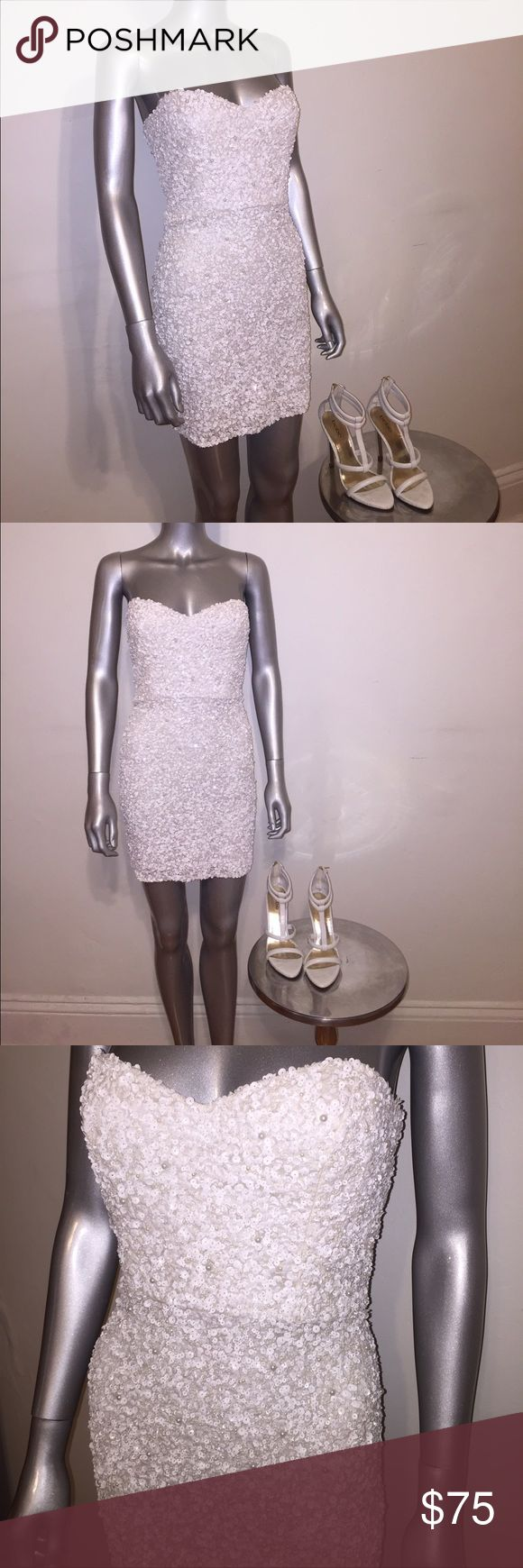 Parker strapless sequin mini dress Parker strapless mini dress embellished with tons of beautiful white sequins, sweetheart top size 6, brand new, broken zipper but I'm willing to fix it if sold at full asking price. If not sold at asking price, buyer takes responsibility and takes it as is. Parker Dresses Strapless