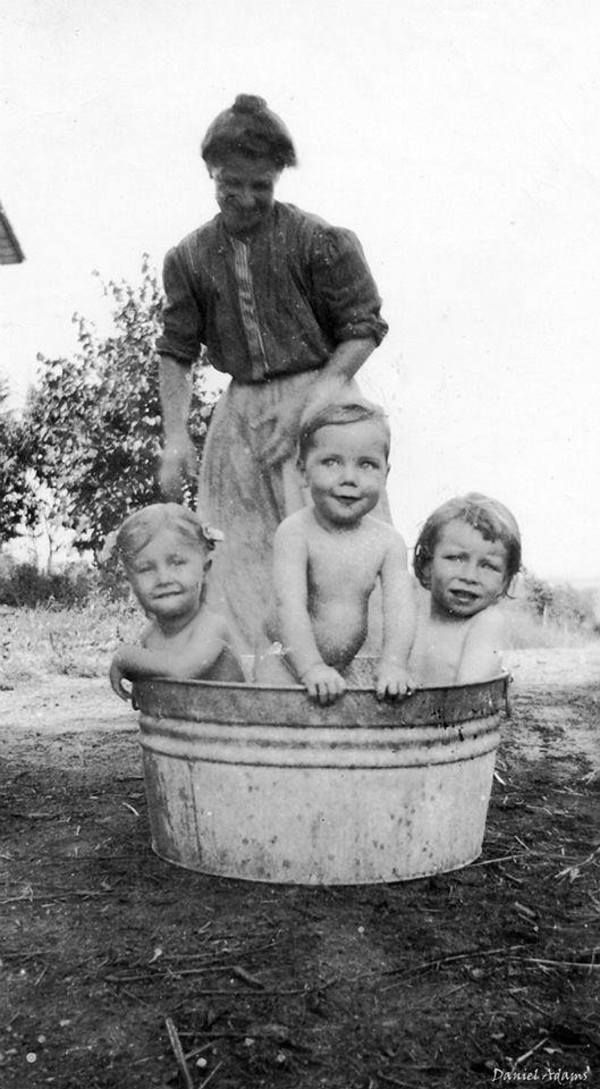 "Daniel Adams: ""Old photo of previous pinner's grandfather in the center of the tub at bath time! He is just too cute! Over 100 years ago!"""