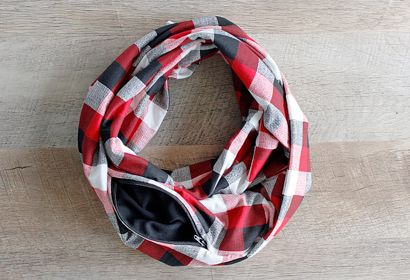 SCARFBAG -  It's a bag, it's a scarf -- it's a scarfbag! The perfect gift for anyone who hates having to carry a purse, this handmade infinity scarf is an accessory that does double duty to hold valuables inside a zippered stash pocket.