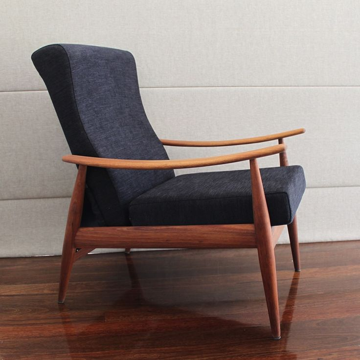 Quite a rare armchair from TH Brown with classic upswept arms. All solid teak frame.