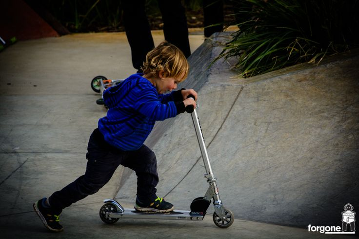 Kid riding a scooter in the skate park in Fremantle, Western Australia