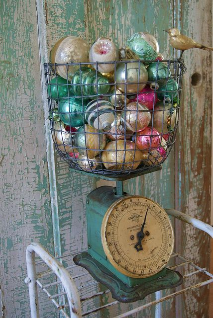 I'm going straight to work and updating my shop window display. My scales are red and I've sold out of pale vintage baubles, so I'll use what I have left.
