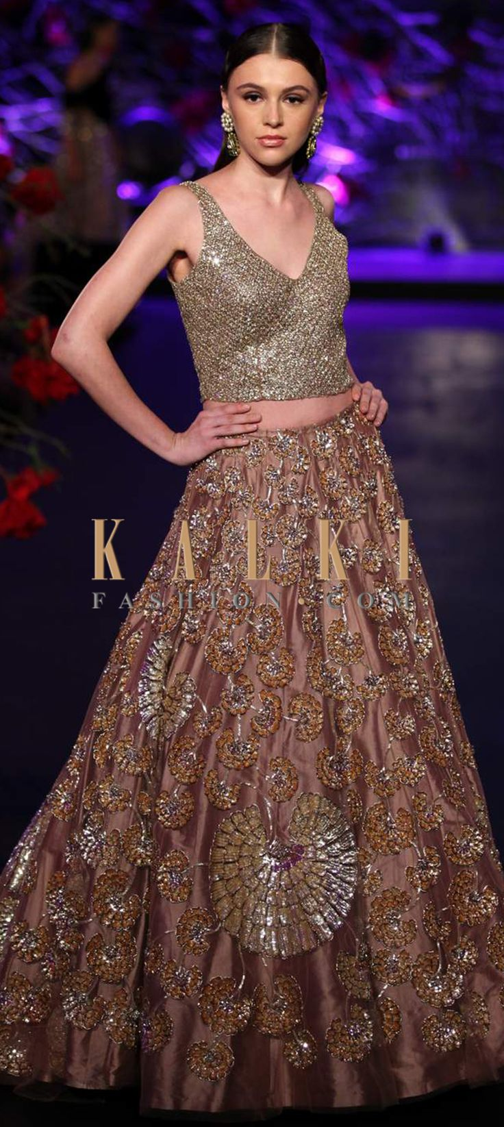 Click on the following link - http://www.kalkifashion.com/designers/manish-malhotra.html