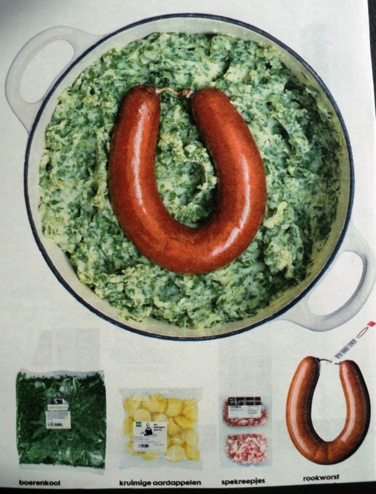 Boerenkool met worst - Dutch food in winter   Kale, potatoes, bacon pieces, with a sausage.