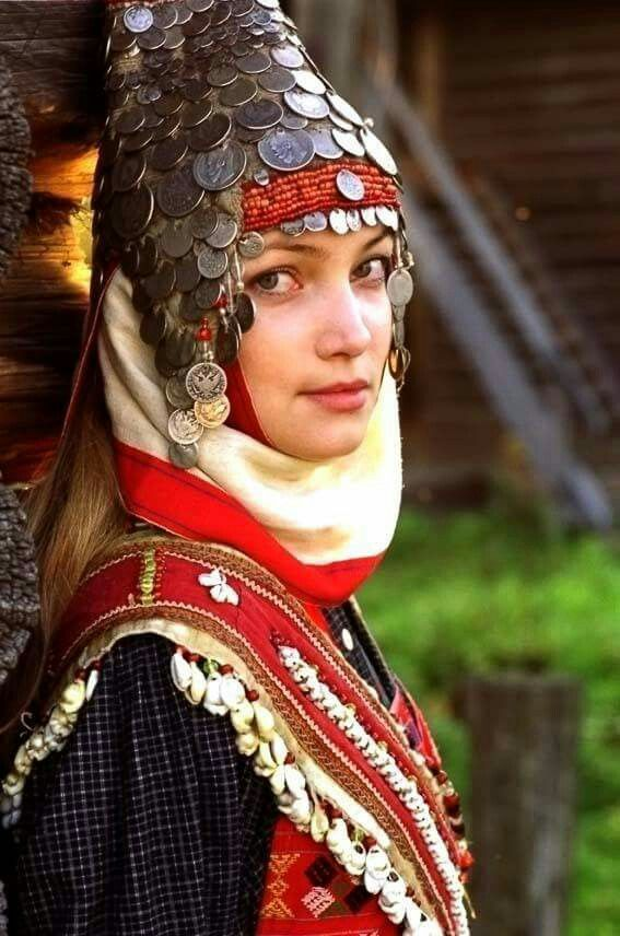 Chuvash woman. Chuvash people claim to be descendent from the Volga Bulgarians. Their traditional clothes are the same as Danube Bulgarian, yet they have adopted a turkic language as a result of invasians.