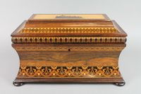 """Lot No 1113 A Victorian Tunbridge Ware twin compartment tea caddy of rectangular waisted form, the lid inlaid a with a view of Eridge Castle, the interior fitted a mixing/sugar bowl, raised on bun feet in the manner of Edmund Nye, 7""""h x 13""""w x 7""""d, est £400-600"""