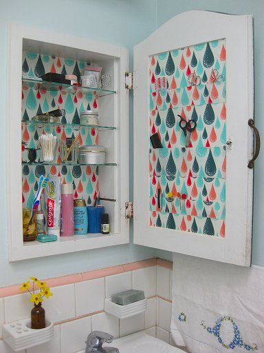 Makeover your dull medicine cabinet with some pretty paper.