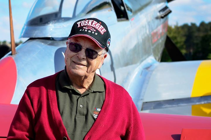 U.S. Air Force retired Lt. Col. George E. Hardy a Tuskegee Airman stands next to his former P-51D Mustang at Royal Air Force Lakenheath England Oct. 4 2016. The Tuskegee Airmenwere an all African-American fighter group during World War II and consisted of more than 900 pilots who maintained and flew combat missions while overseas. (U.S. Air Force photo/ Senior Airman Malcolm Mayfield)