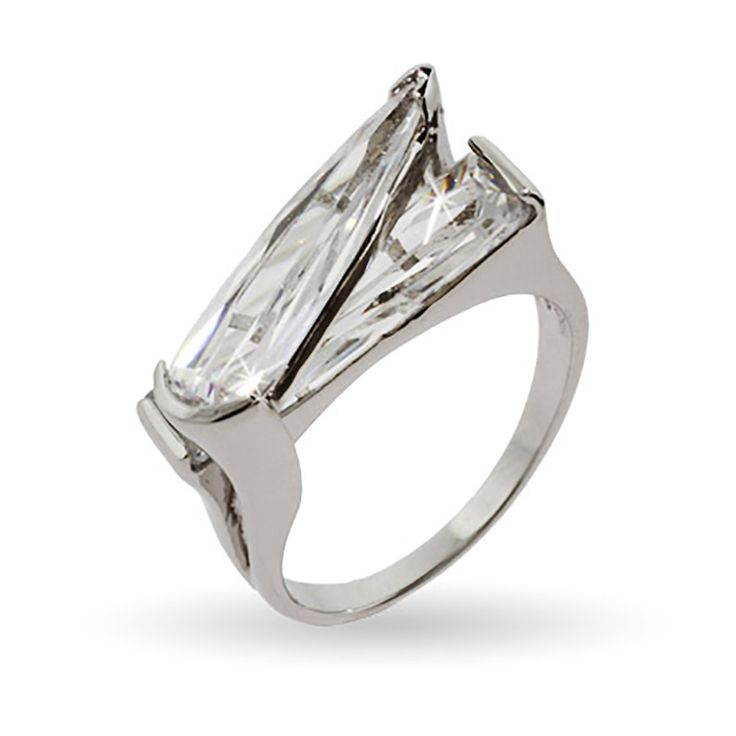 This Edgy CZ Rocker Right Hand Ring is a stylish ring that will add some bling to any outfit. An elongated tear drop cut cz is strewn across a larger rectangular cz, giving it that careless but sleek style that makes for a great attention grabber.  This ring is available in sizes 6 through 9 and can be worn on any finger.  Dress this up for a night out, or make it punky with other cutting edge jewelry.