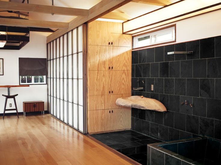 Kartheiser's open space bathroom with a closet, concealed by screens.  The 580 Sq Ft Hollywood Cabin of Vincent Kartheiser in interior design architecture  Category