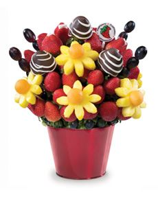 Orders Incredibly Edibles Fruit Arrangement | Price: $65.95* Dazzling Tulips & Daisies Dipped™