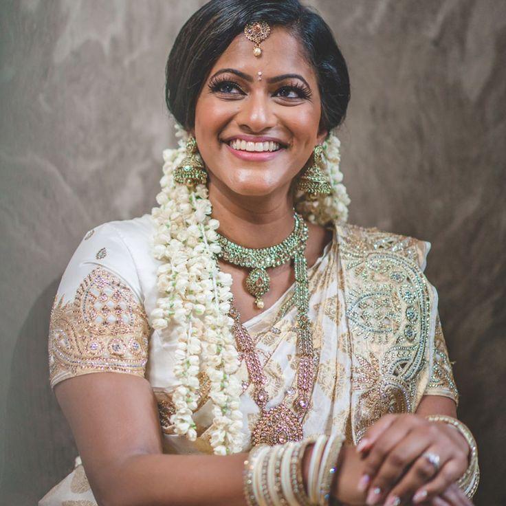 """Bride Doll""  James & Elil's Tamil Hindu Wedding   Photography-  @black_magic_creations   Creative Director- @shana_mahendran   MUA - @jumani.mua   #whitesaree #bride #hinduwedding #photography #blackmagiccreations  #makeup  #weddingphotographer #nextdayedit #fulloflaugh #sheisadorable #jasmine #flowers #portrait #hotelshoot #bridalshoot #gettingready"