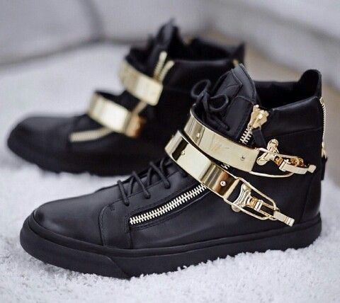 Giuzeppe Zanotti black and gold shoes.