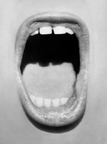 Sandra Bernhard by Herb Ritts. The shape on the tongue reminds me of a city scape