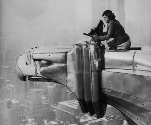 Margaret Bourke White taking a photo from one of the gargoyles atop the Chrysler Building, NYC 1934
