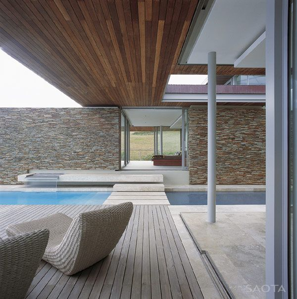 quite nice stone feature wall, like the wood panelling and wood/stone foor mix as well as path over water however that would be for one of the not so family-friendly villas. Cove 6 Residence by SAOTA Perched Above a Dramatic Seascape