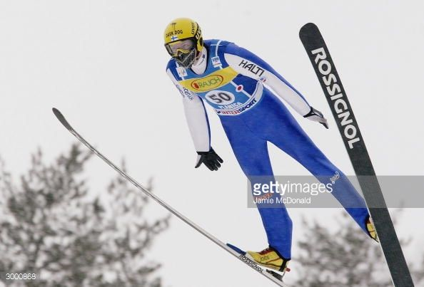 Tami Kiuru of Finland flys to third place during the FIS Ski Flying World Cup on February 21 2004 in Plancia Slovenia