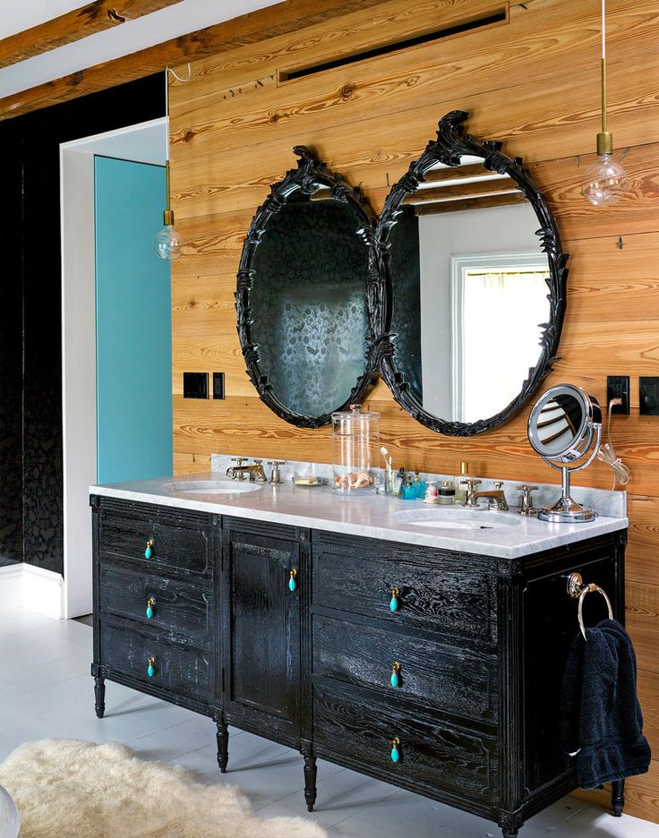 """Mike D. as in from the Beastie Boys' Cobble Hill Home: The mirror was found on Craigslist and painted black. The Restoration Hardware cabinet was also repainted, and its pulls were changed. """"We love the color combination of black and white and this shade of blue,"""" Ms. Davis said."""