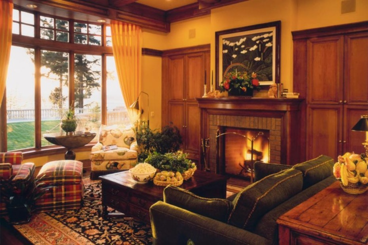 Classic and timeless living room design with a beautiful fireplace. Discovered on www.Porch.com