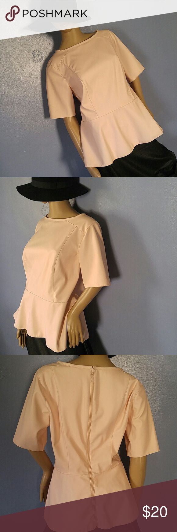 "Dennis Basso Soft Pink Vegan Leather Peplum Top Soft Pink Vegan Leather Peplum Top Very Cute ! Back Zipper Opens Fully. Very Soft inside Lining Machine Washable. Was purchased on QVC Sleeves: 11"" Bust: 40"" Total Length: 25"" Peplum Waist : 36"" Fits size 10 Dennis Basso Tops"