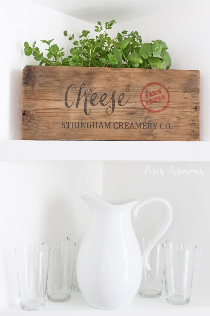 Love this DIY cheese crate with herbs on shelf. It actually is built to fit into a triangular shelf. Amazing!