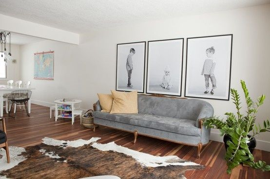 Oh, I'll be getting a giant zebra print or cow skin rug.  Seriously.  I will be putting them EVERYWHERE.  Love the giant pictures.  Neutral couch - nice.  Not the giant dark monstrosities I tend to go for.