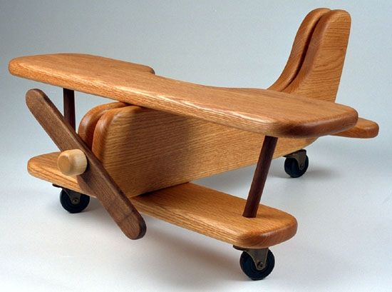 Riding wooden airplane. Need!