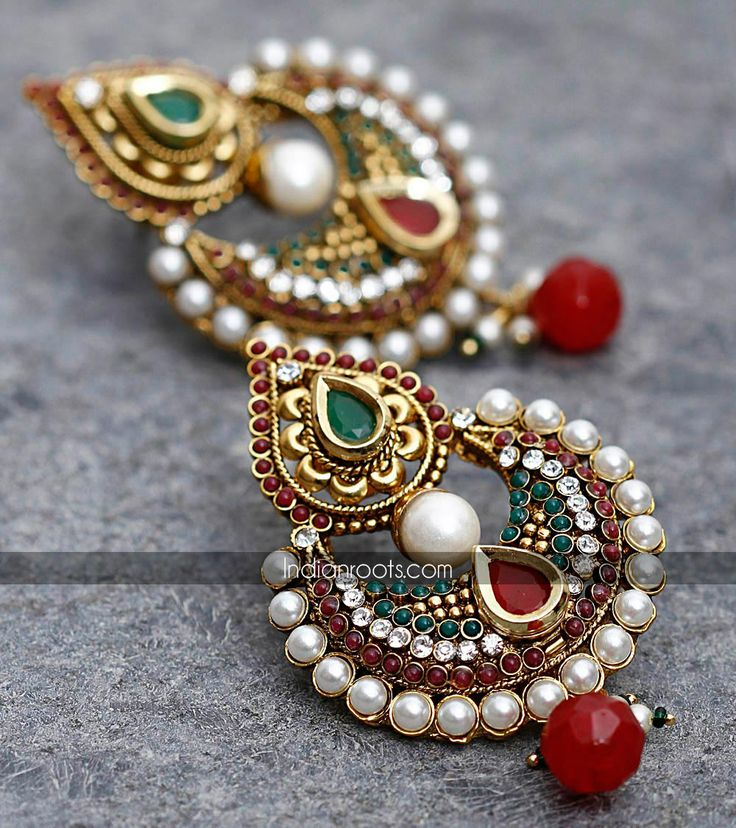 Pair of handcrafted pearl and stone embellished earrings by Feminine on Indianroots.com