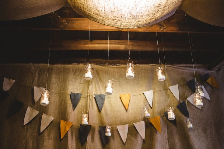 Camp Circa. Circa Lighting's Holiday Party 2013.  Design was inspired by the great outdoors and all things camp(y). Design by Rethink Design Studio | Savannah, GA |   DIY felt pendants and hanging mason lanterns. Burlap wall divider.