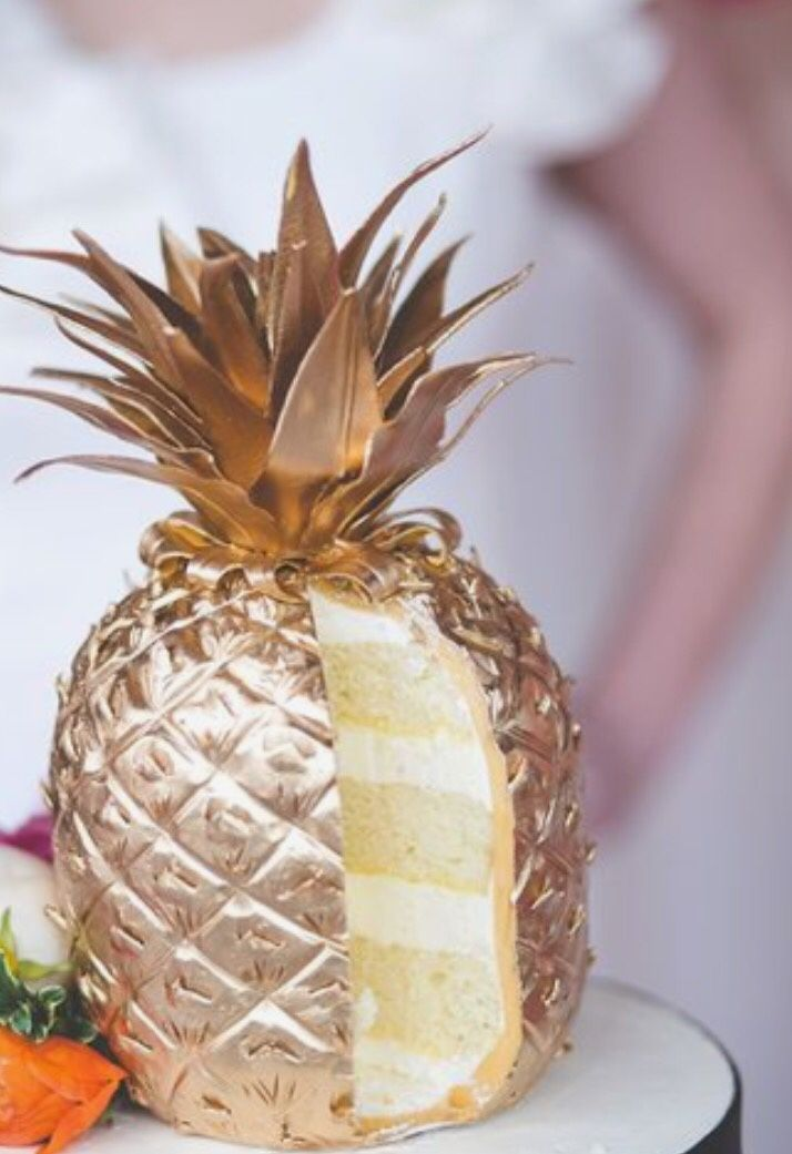 A cocktail in her hand and confetti in her hair. : may i have a gold pineapple?
