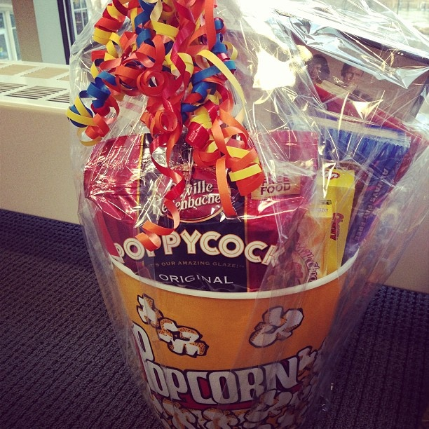 Movie Night Silent Auction Basket. Get a 5 dollar movie from Target, some candy, popcorn, and pop and toss it into a popcorn bowl! Add a ribbon for good measure :)  University of St. Thomas Relay For Life 2013