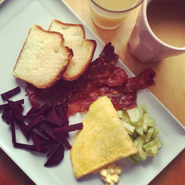 My saturday breakfast: toast (glutenfree) Apple juice, coffee, beetroots, omelette , cucumber, mayo And Always: Bacon!