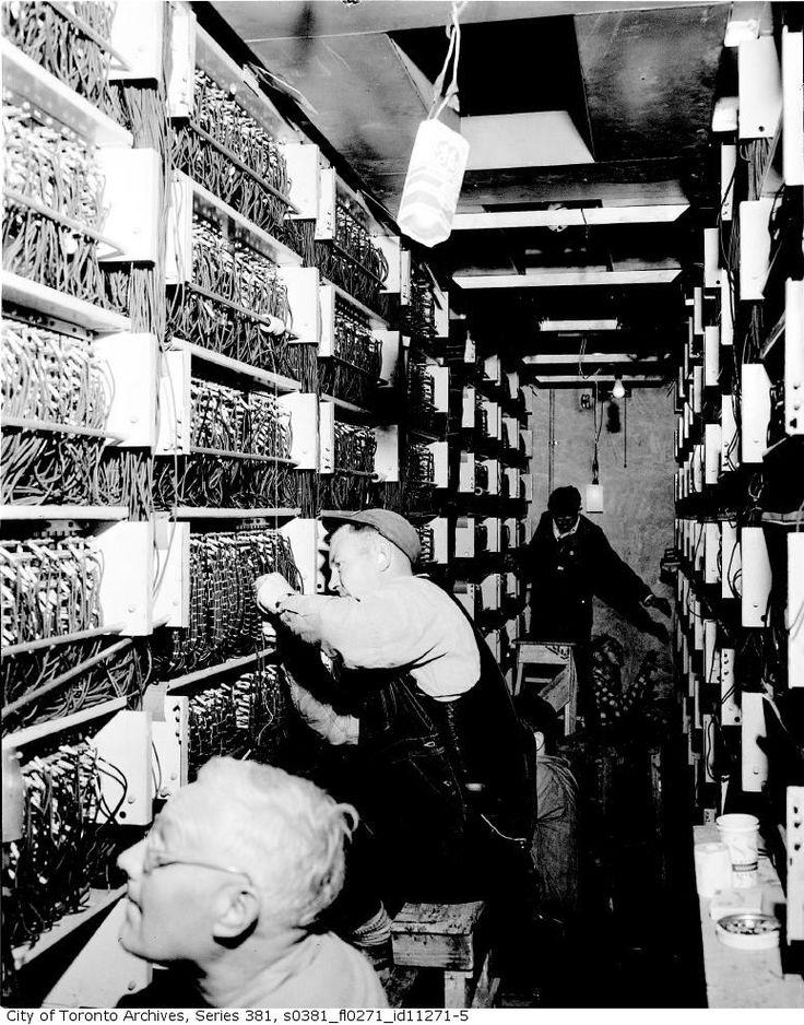 Signalmen wiring relays for Toronto subway signal and switch control Davisville Tower c1953