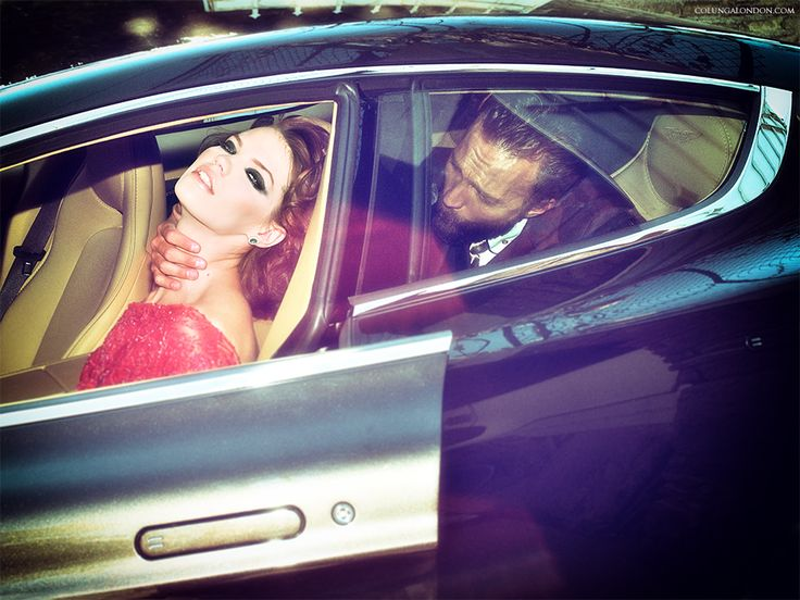 Car: Aston Martin Rapide S. Her: Couture gown by COLUNGA. Jewellery by Daniela Norinder. Him: Shirt & suit by Vivienne Westwood Man. Necktie by COLUNGA.