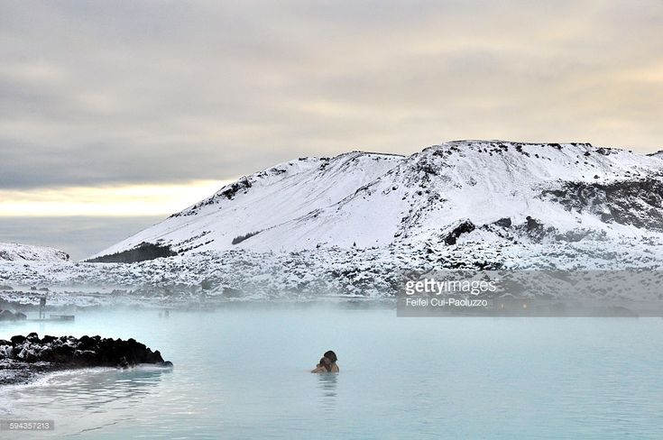 Couple at Thermal pool Blue lagoon, Reykjanes Peninsula, Iceland. The Blue lagoon geothermal spa is one of the most visited attractions in Iceland. The spa is located in a lava field in Grindavík on the Reykjanes peninsula, southwestern Iceland.