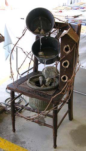 Wonderful garden junk fountain on an old chair!