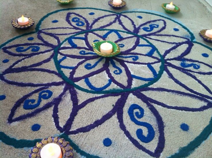 Beautiful and unique rangoli, battery operated tea lights for diyas instead of oil.