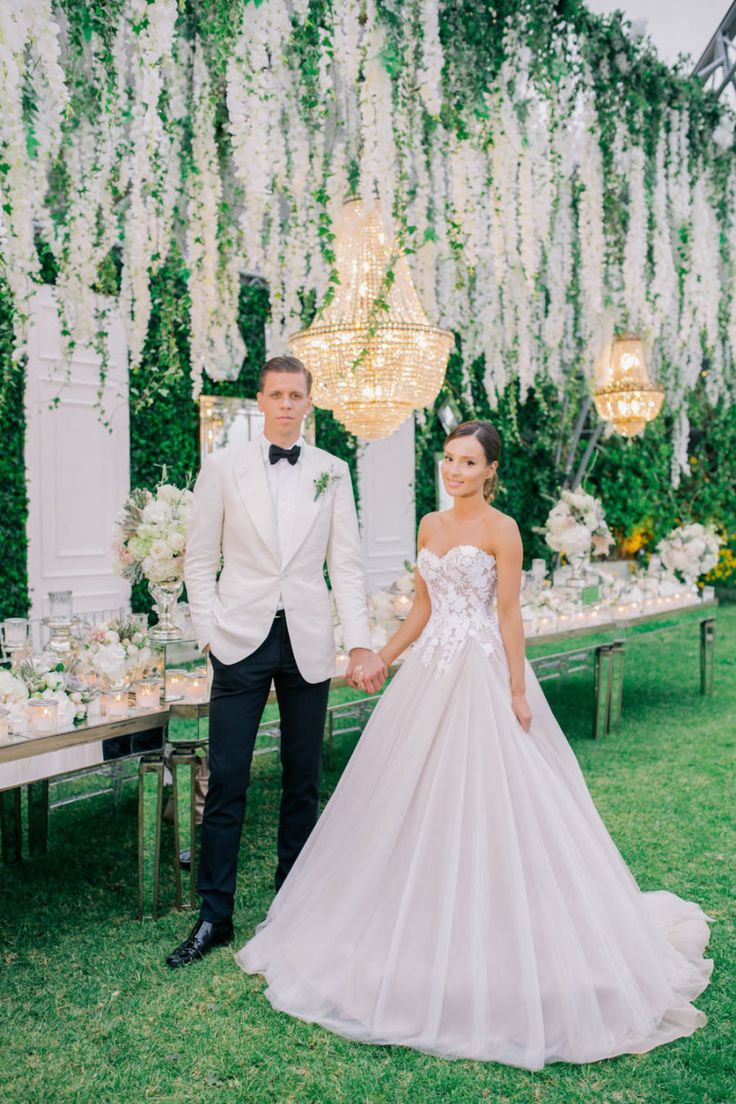 Groom's Attire: Tom Ford - http://www.stylemepretty.com/portfolio/tom-ford Wedding Dress: Mira Zwillinger - http://www.mirazwillinger.com Photography: Anna Roussos - annaroussos.com   Read More on SMP: http://www.stylemepretty.com/2016/11/07/this-greek-wedding-is-total-floral-goals/