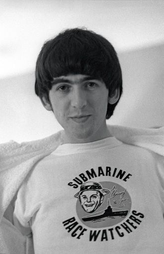 """Ringo Starr on George Harrison: """"""""That's George wearing one of Murray the K's T-shirts. He broke The Beatles in America by playing our record on his Submarine Race Watchers show. He talked in a very weird language, which we couldn't understand, but it seemed like everyone in New York did. He came on that tour from New York to Washington and to Florida with us. We have to thank him. He was a great guy.""""  - Exclusive Beatles Photos from Ringo Starr's New Book"""