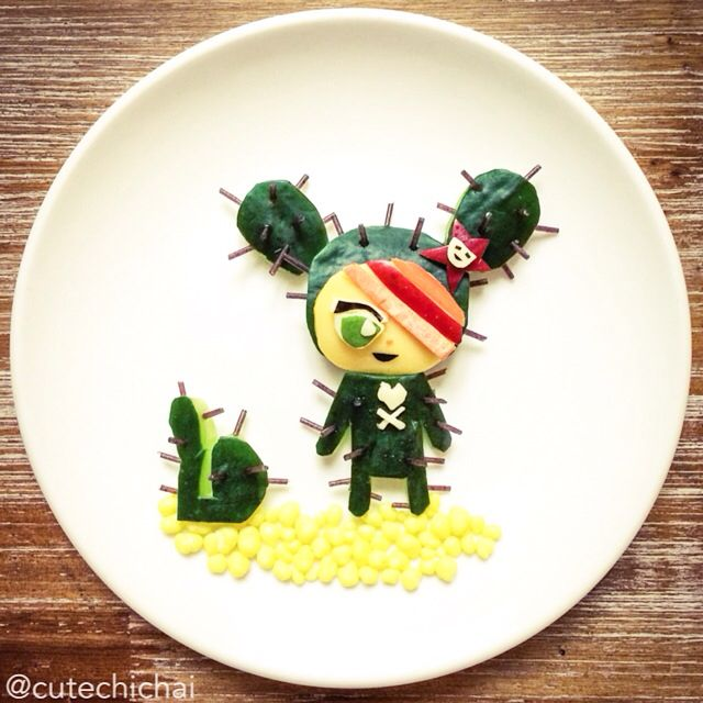 Food Art. Another Tokidoki character--Cactus Girl. Made with cucumber and raw black vermicelli for the thorns.
