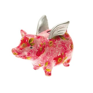 Save your spare change in this silver winged pig money bank decorated with flowers.