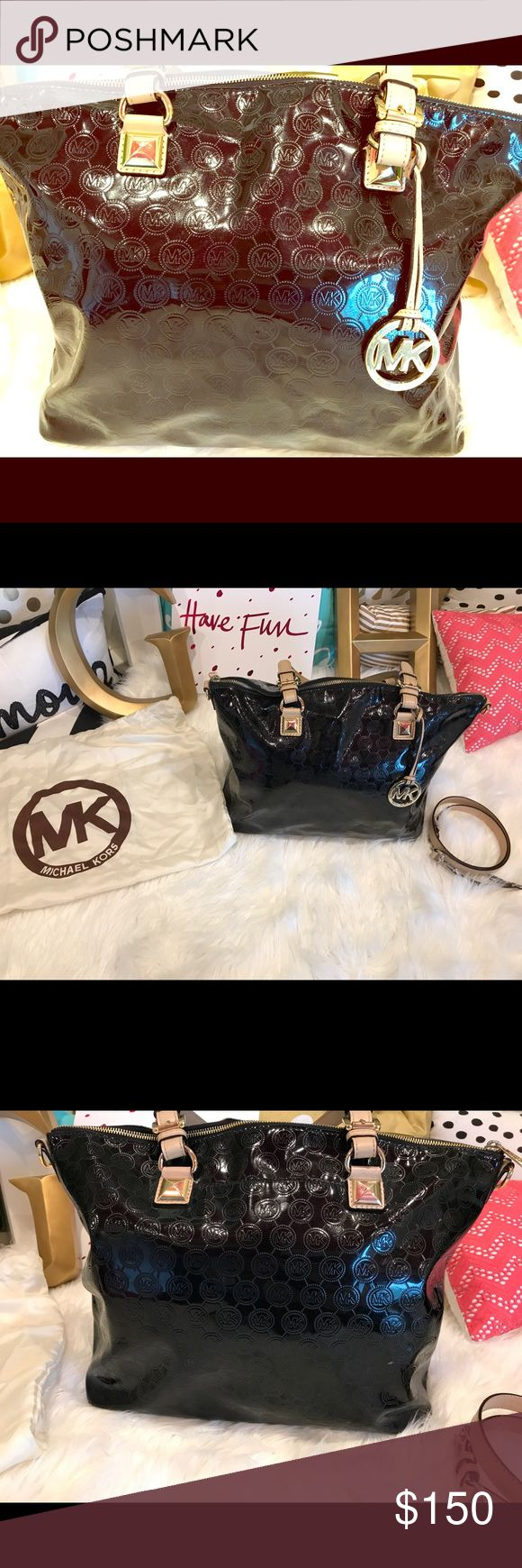 Michael Kors handbag This is a patented leather black authentic Michael Kors handbag. Michael Kors Black Signature Patent Leather Gloss Large Jet Set Tote. Like new, barely used! Michael Kors Bags Shoulder Bags