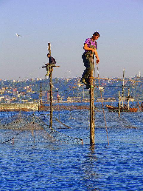 Pole fishing in Istanbul, Turkey by Fatih Kocaoglu