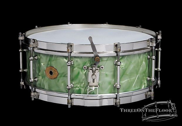 Slingerland 1930s Tone Flange Model Snare Drum with Sea Green Pearl finish. This drum came from the collection of Cheep Trick's Bun E. Carlos. The drum is complete with a banjo ring which sits on top of the batter bearing edge in addition to the tone flange. Due to the oversized nature of these Tone Flanges, the batter head is set on top of the banjo ring as it will not stretch the diameter with the flange installed.