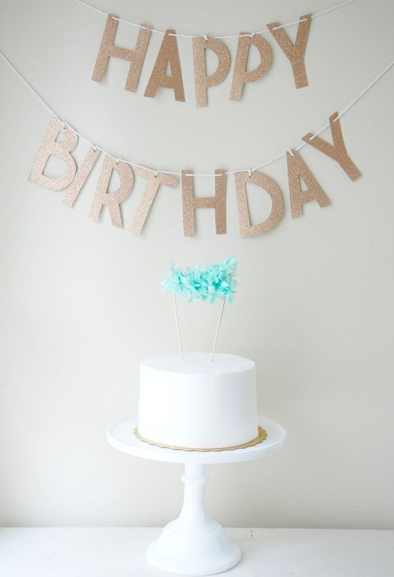 Simple decorations can go a long way - like this custom glitter banner and blue cake topper!